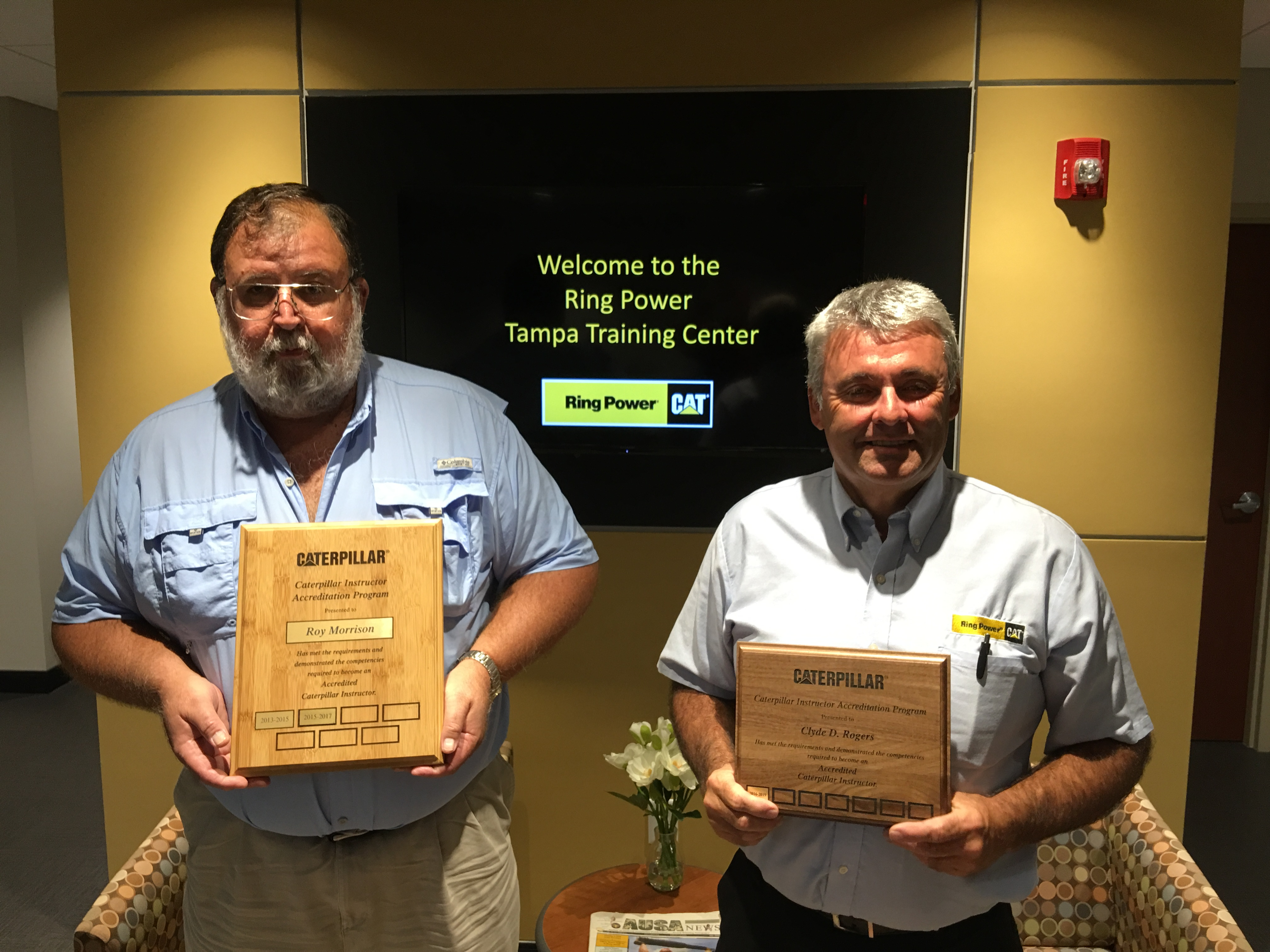Roy Morrison (left) and Clyde Rogers with their CIAP Certification plaques