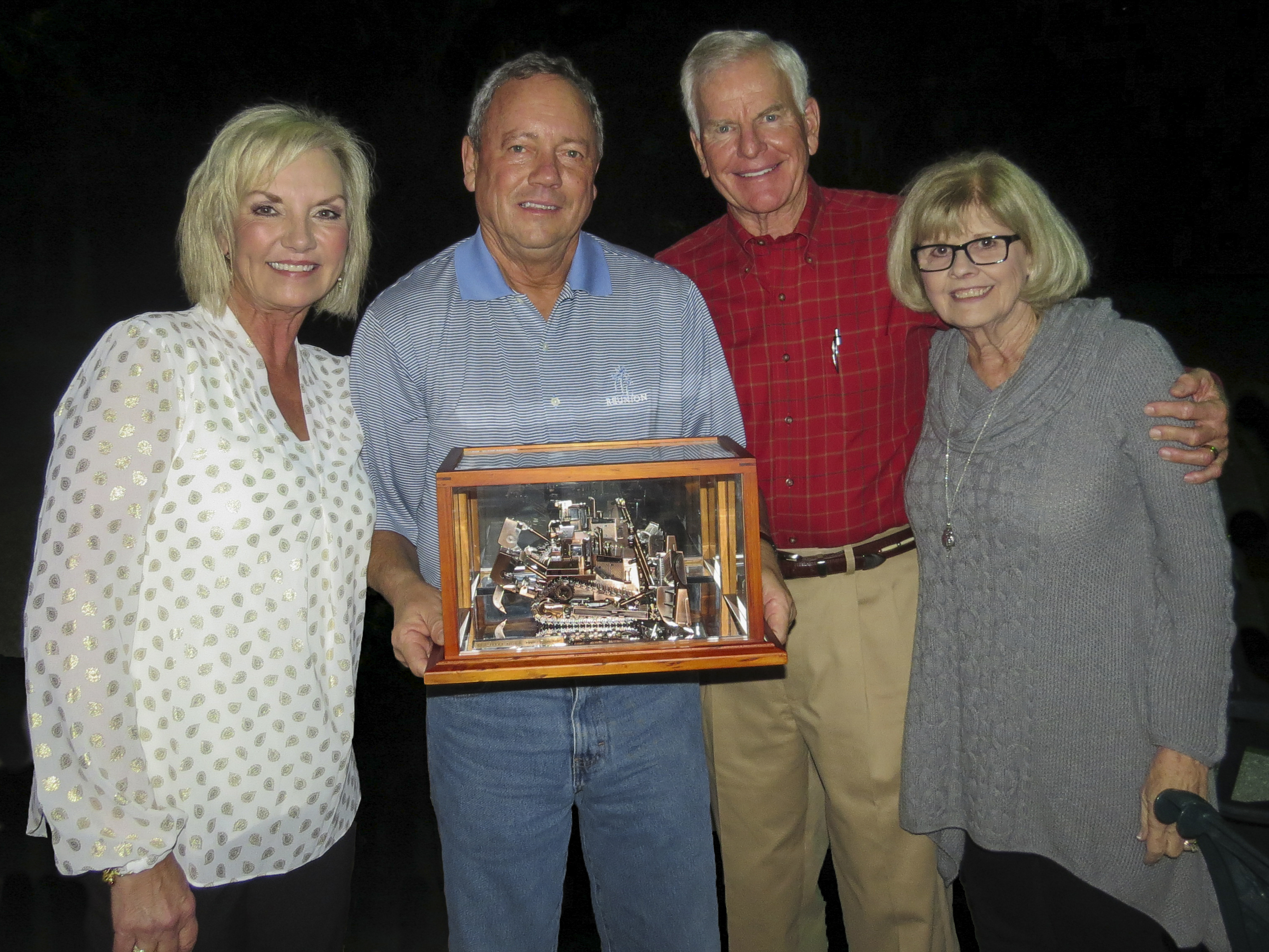 - Paula Ringhaver, Frank Fowler, Randy Ringhaver, & Lynne Fowler are pictured at a board of directors meeting where Frank Fowler was presented with a commemorative collector model Cat D11T tractor.