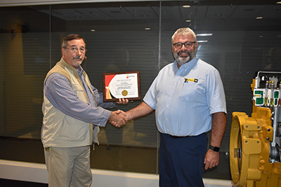 Clyde Rogers receives his certificate for IFPS from Gabe Sacco.