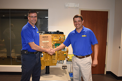 Devin Rawn receives his Caterpillar Instructor Accreditation certificate from Abel Posada.
