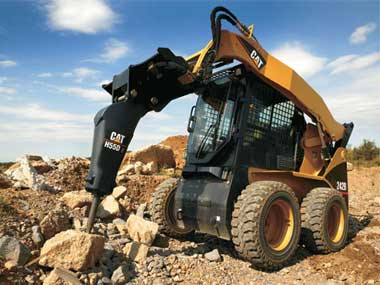 CAT Skidsteer with Hammer Attachment