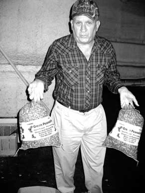 Gene Waldron Shows Famous Green Peanuts