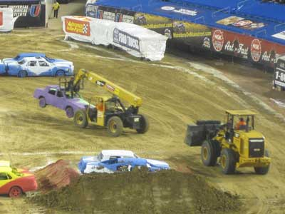 CAT Telehandler moves car during Monster Jam